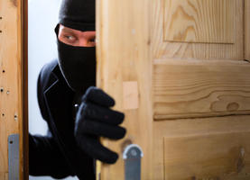 burglar burglary security thief theft criminal crime insurance door mask hooded balaclava alarm apartment house office rob consultation kidnap robber stealing robbery open protect protecting man male person people