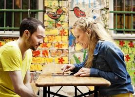 Young Couple with Tablet Computer at Cafe